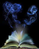 Abstract of  open book page with moving smoke on black backgroun — Stock Photo