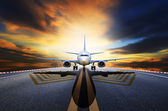 Passenger jet plane preparing to take off from airport runways a — Stock Photo
