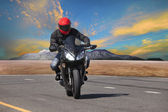 Young man riding motorcycle in asphalt road curve use for extrem — Stock Photo