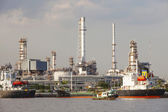 Oil refinery and tanker ship on port in heavy industry use for e — Stock Photo