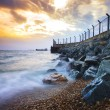 Постер, плакат: Sea scape at rock dam protection coast from wave impact against