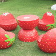 Set of red strawberry garden outdoor patio desk on green grass f — Stock Photo #50910353