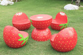 Set of red strawberry garden outdoor patio desk on green grass f — Stock Photo