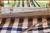 Weaving shuttle on thai tradition clothes weaving  — Stock Photo