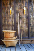 Thai bamboo basket hand craft with wood wall  rural home scene i — Stock Photo