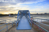Perspective of metal bridge for working in big tank of water sup — Stock Photo