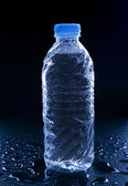 Water bottle on black with refreshment dew use for beverage and  — Stock Photo