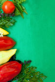 Background edged with the vegetables and greens — Stock Photo