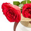 Stock Photo: Rose fragrant bouquet on lady's hat
