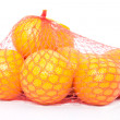 Stock Photo: Oranges in string bag