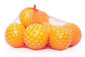 Oranges in the string bag — Stockfoto