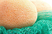 Big and ripe melon on the wicker bag — Stock Photo