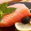 Stock Photo: Portion of delicious salmon with basil, lemon and olives