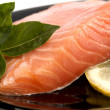 Stock Photo: Plate with appetizing salmon, basil and lemon