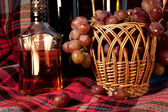 Close-up still life made by the wine, cognac and grapes in the b — Stock Photo