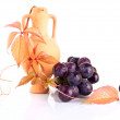 Stock Photo: Beautiful earthenware amphorwith vine twig and grape