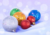 Christmas toys on the snowy background — Stock Photo