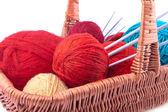 Wicked basket with yarn and needles — Stock Photo