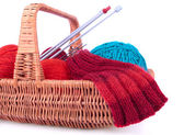 The fragment of the wicked basket with knitting — Stock Photo