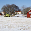 Red farmhouse, snow and winter - Foto Stock