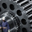 Gears machinery and industry workers — Stock Photo