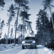 Suv, car driving through a winter landscape — Stockfoto