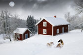 Old red cottages, winter landscape — Stock Photo