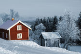 Old red cottages, winter and snow — Stock Photo