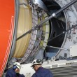 Stock Photo: Airplane mechanics and jumbo jet engine