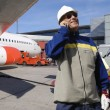 Stock Photo: Air mechanic and airliner
