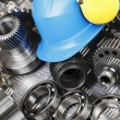 Stock Photo: Hardhat and engineering gears