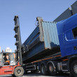 Stock Photo: Forklift stacking cargo containers