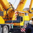 Engineer with large mobile construction cranes - Stock Photo