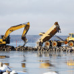 Bulldozer dredging in the sea — Stock Photo