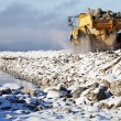 Bulldozer dredging in the sea - Stock Photo