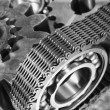 Stock Photo: Gears and cogs driven by timing-chain