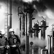 Refinery workers and industry, vintage look - Stock Photo