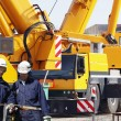 Building workers and giant mobile cranes — Stock Photo #21553601