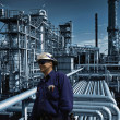 Stock Photo: Oil workers inside refinery, late night-shift works