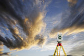 Surveying instrument and sunset horizon — Stock Photo