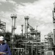 Stock Photo: Oil workers inside oil and gas refinery