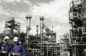 Oil workers inside oil and gas refinery — Stock Photo