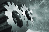 Gears and cogwheels in action — Stock Photo