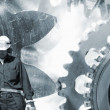 Industry workers and giant machinery — Stock Photo