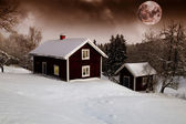 Red moon rise over old cottages — Stock Photo