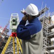 Stock Photo: Surveyor with instrument