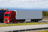 Large truck driving a scenic route — Stock Photo