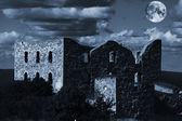 Old derelict castle ruin under a full-moon — Stock Photo