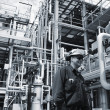 Oil workers and refinery industry — Stock Photo