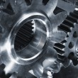 Gears and cogs in titanium and steel — Stock Photo